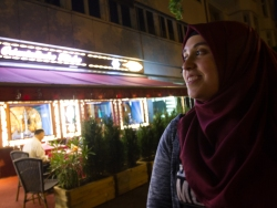 After breaking her fast, Raziye Bagci leaves a traditional Turkish restaurant. Berlin, Thursday, June 9, 2016. Photo by Adam McCaw
