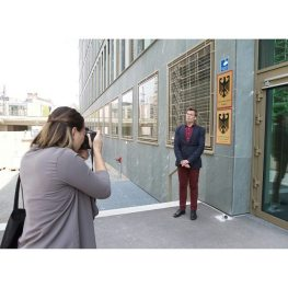 Kira Vercruyssen shoots a subject outside of the Federal Anti-Discrimination Agency in Berlin.