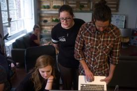 Kayla Robertson, Alyssa Rochelle and Adam McCaw make final changes to stories on the last day working in Berlin.