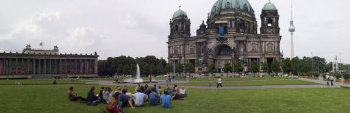 The students listen to a guest speaker on the lawn of the Berliner Dom.