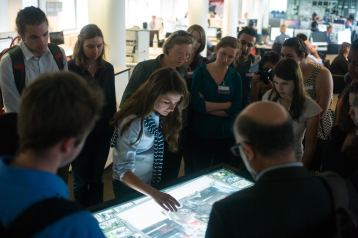 Students watch as the editor of BILD Zeitung, a conservative tabloid-style publication, shows photos from the latest issue of BILD Zeitung.
