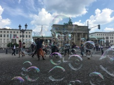 """Today is my first day in Berlin. I come from Poland. This is a very cool city for street performers. I like children and I can make bubbles, so I make bubbles in the street."" — Street performer Adrian Golabawski near Berlin's Brandenburg Gate. 