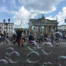 """""""Today is my first day in Berlin. I come from Poland. This is a very cool city for street performers. I like children and I can make bubbles, so I make bubbles in the street."""" — Street performer Adrian Golabawski near Berlin's Brandenburg Gate. 